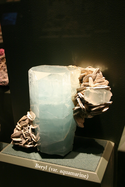 Aquamarine Facts - Sometimes Aquamarine appears to have a yellowish hue, representing the iron inclusions within the stone.  It is usually treated with heat to remove this coloration.