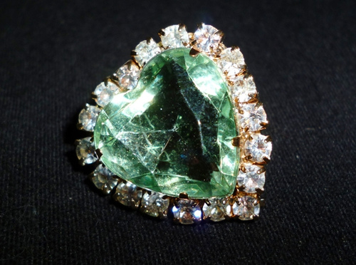 "The name Emerald was first translated from the Sanskrit word Marakata, which means ""the green of growing things.  The Greeks also used the word smaragdus meaning ""green"" to describe the gem. -- Emerald Gemstone Meaning"