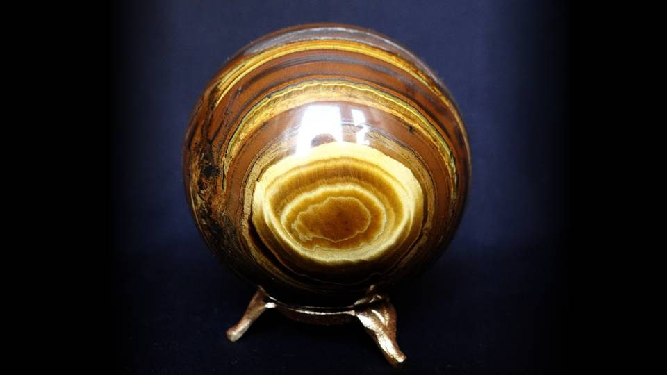 Tiger's eye has many properties about it that make it a balancing stone.  It can balance the yin and yang, and it manages the energies of the Sun and the earth. -- Metaphysical and Spiritual Properties of Tigers Eye Stone